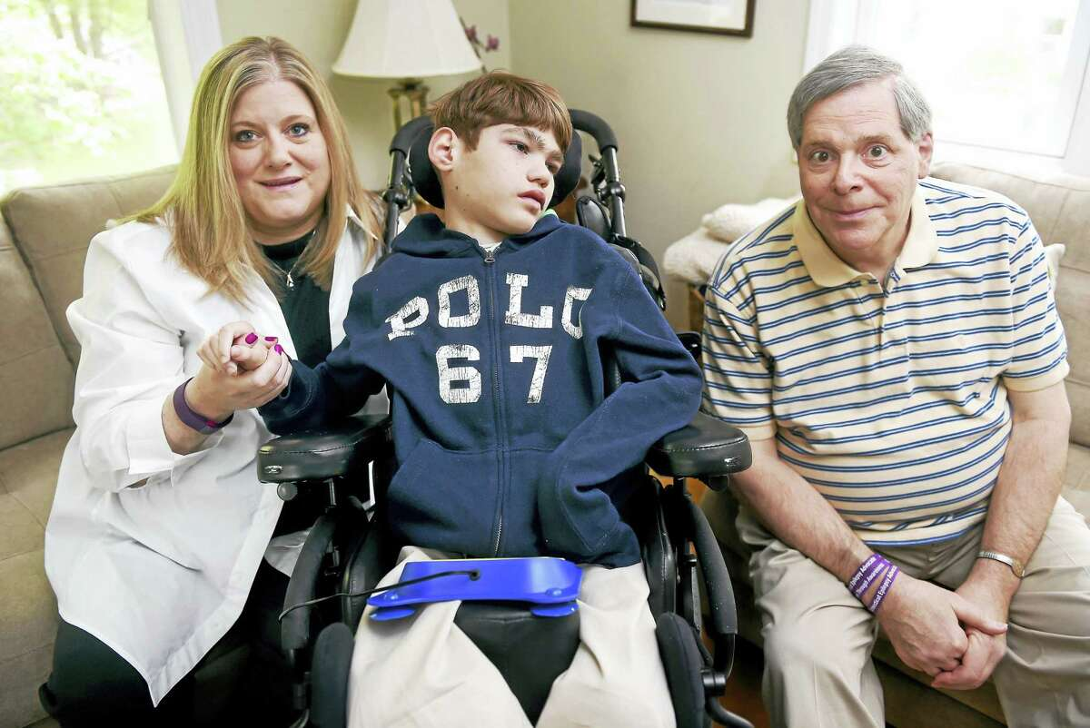 Left to right, Kim Hearn is photographed with her son, Sean, 11, and Robert Fiore, president and founder of Connecticut Epilepsy Advocate, Inc., at Hearn's home in Stratford on 5/21/2016.