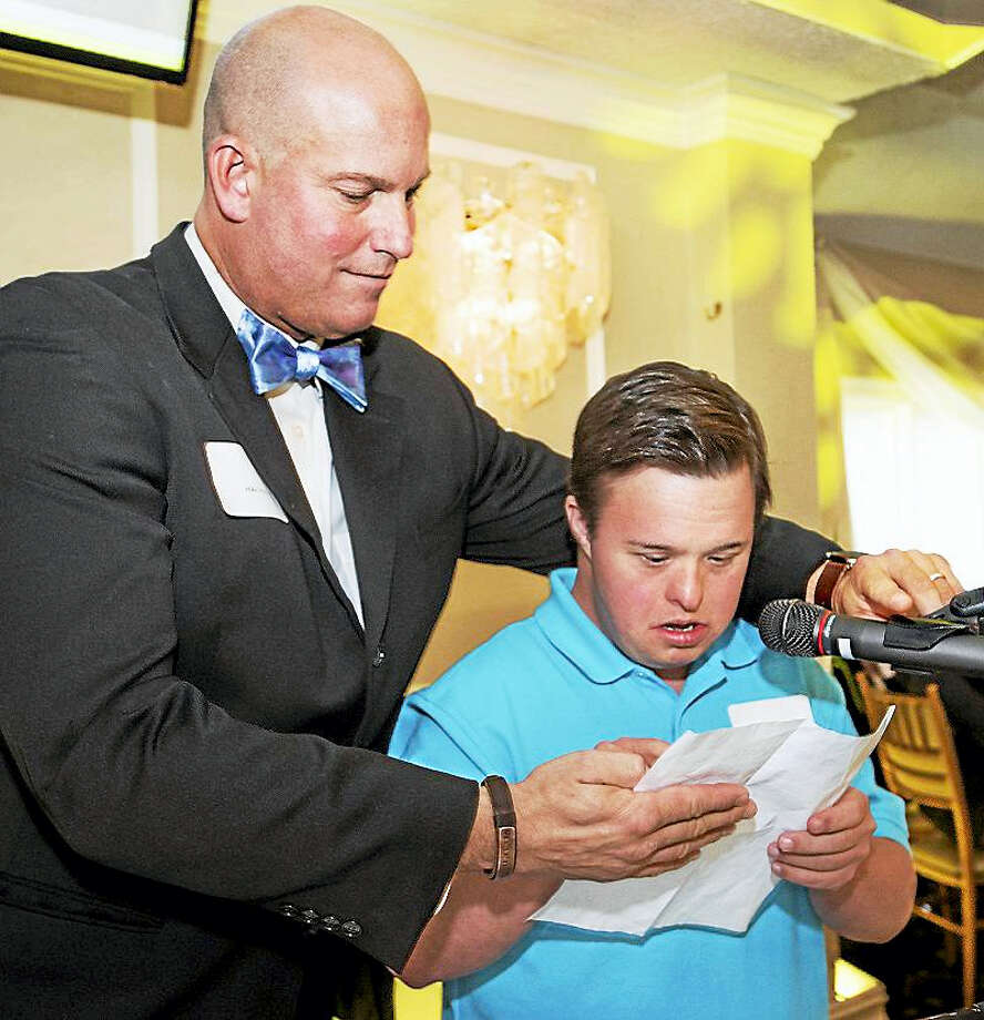 Chapel Haven president Mike Storz helps student Matthew Biles, who spoke at the organization's annual brunch, where a major capital campaign was formally announced in order to carry out a major expansion and modernization of the campus. Photo: Melanie Stengel/ For Chapel Haven