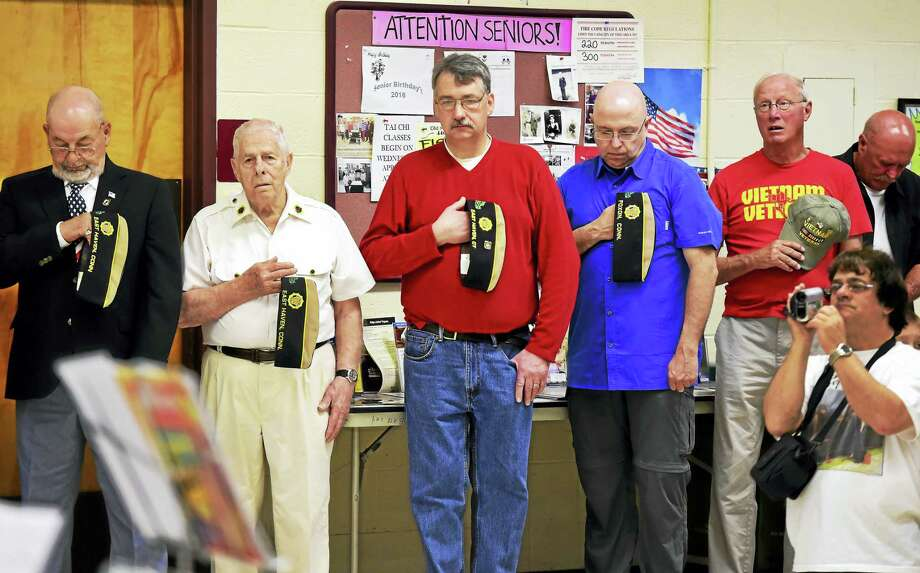 American Legion Post 89 of East Haven veterans pause for a moment of silence honoring deceased veterans during a  Memorial Day ceremony Monday, at the East Haven Senior Center. Photo: Peter Hvizdak - New Haven Register   / ©2016 Peter Hvizdak