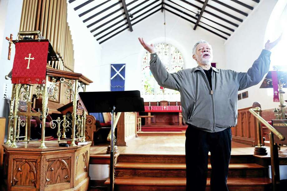 (Arnold Gold-New Haven Register)  Senior Warden Lou Campbell conducts services at St. Andrew's Episcopal Church in New Haven on Sunday 5/15/2016. Photo: Journal Register Co.