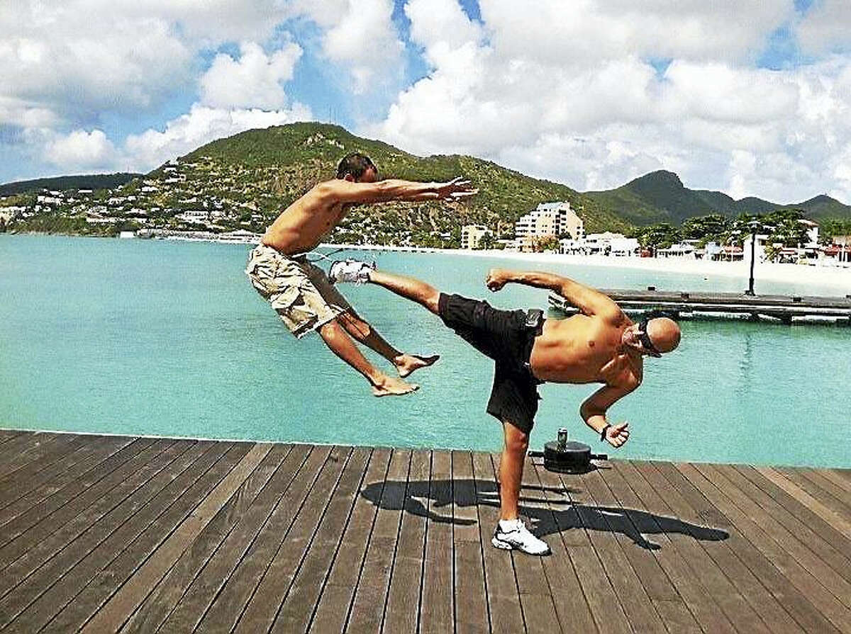 Capoeira master Efraim Silva, right, practices his championship moves on a tour of St. Marteen.