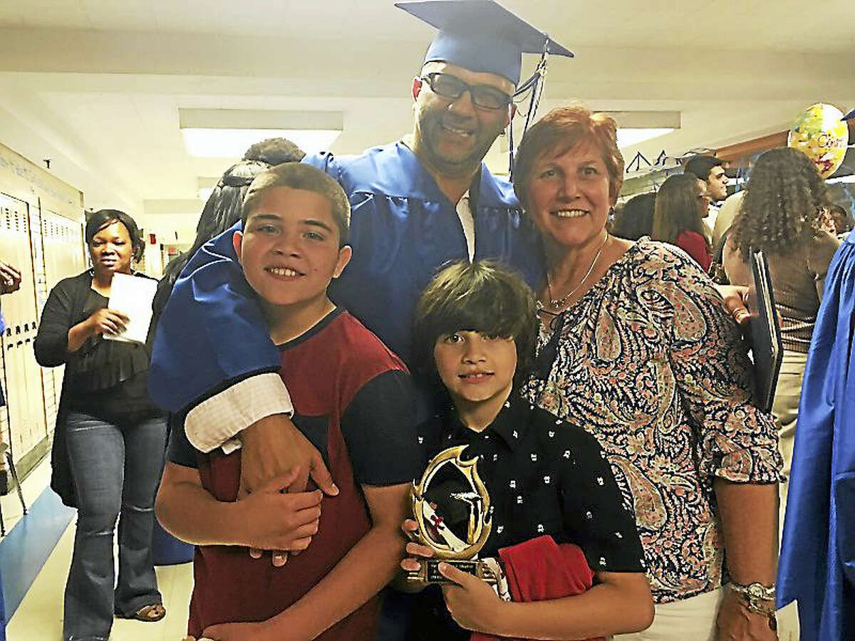Capoeira master Efraim Silva travels the globe performing and teaching, but always felt something was missing - until he graduated recently from West Haven High School Adult Education with a high school diploma. Silva's sons, Kauan, 12 and Lilo, 9, were proud of their dad that night, as was one of his teachers, Deb Papeika.