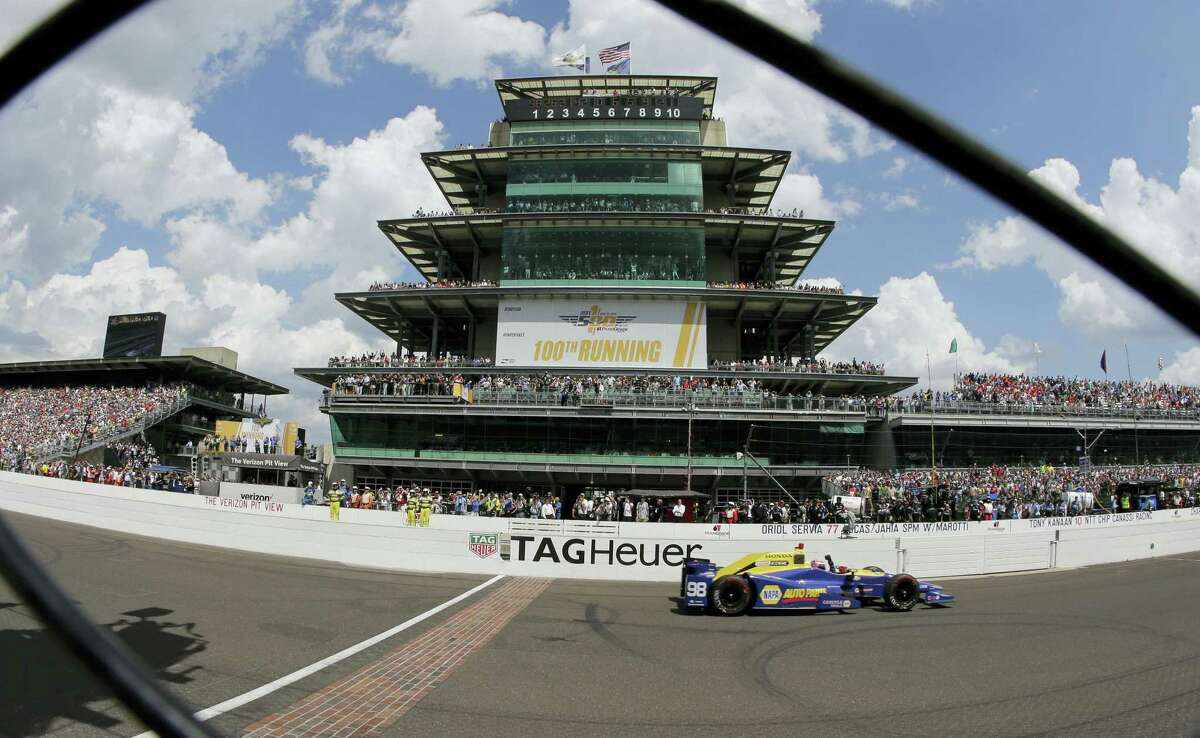 Alexander Rossi crosses the finish line to win the 100th running of the Indianapolis 500 on Sunday.