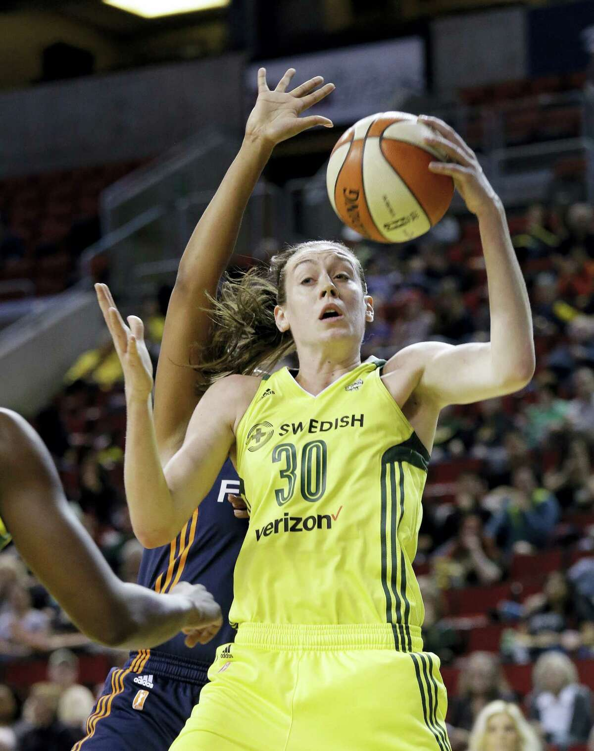 The Storm's Breanna Stewart grabs a rebound against the Sun during the first half on Friday.