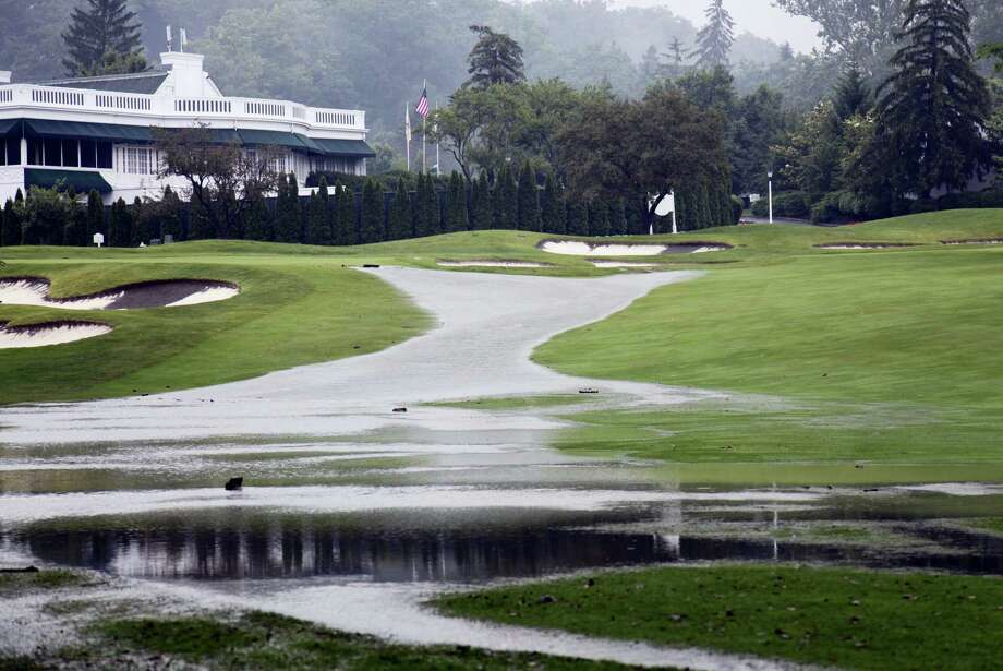 This image from Thursday, provided by the Greenbrier, shows flooding on a fairway in front of the clubhouse of the Old White Course at the Greenbrier in White Sulphur Springs, W. Va. Photo: Harry Watson — The Greenbrier Via AP   / The Greenbrier