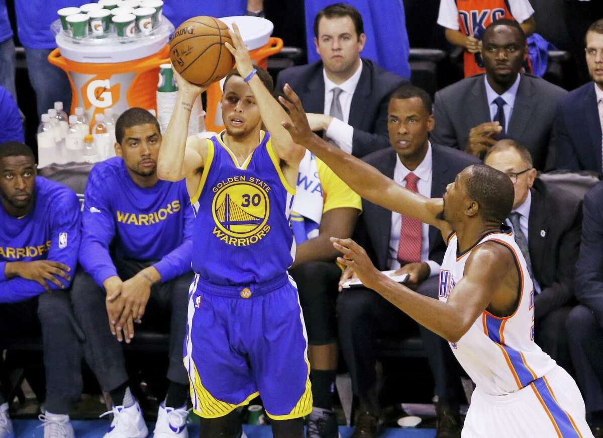 Warriors guard Stephen Curry shoots in front of Thunder forward Kevin Durant during Game 6 of the Western Conference Finals on Saturday.