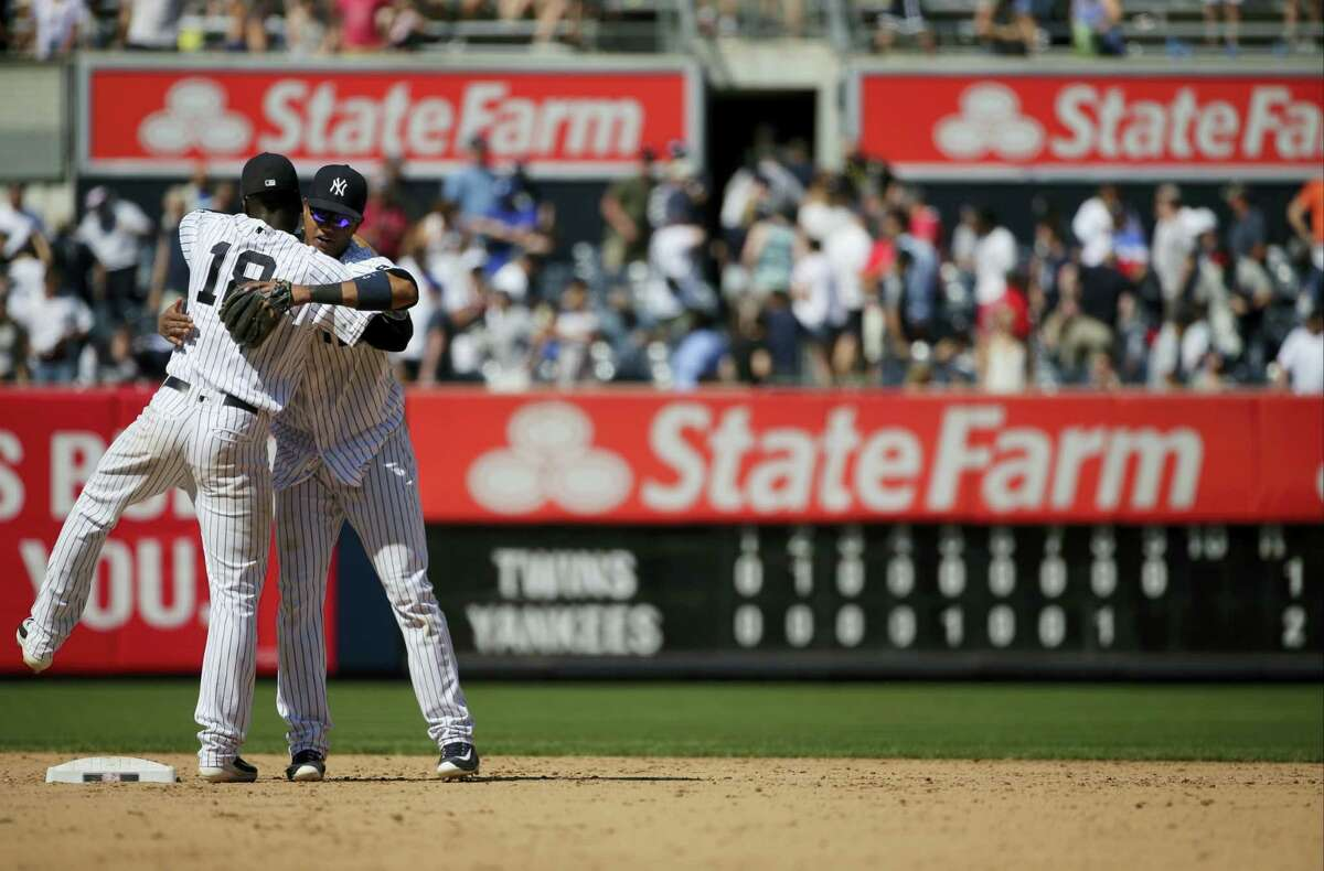 The Yankees' Starlin Castro, right, hugs Didi Gregorius after beating the Twins on Saturday.