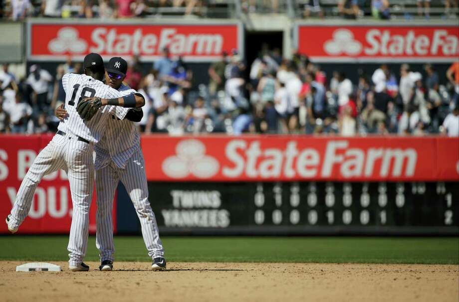 The Yankees' Starlin Castro, right, hugs Didi Gregorius after beating the Twins on Saturday. Photo: Frank Franklin II — The Associated Press   / Copyright 2016 The Associated Press. All rights reserved. This material may not be published, broadcast, rewritten or redistribu