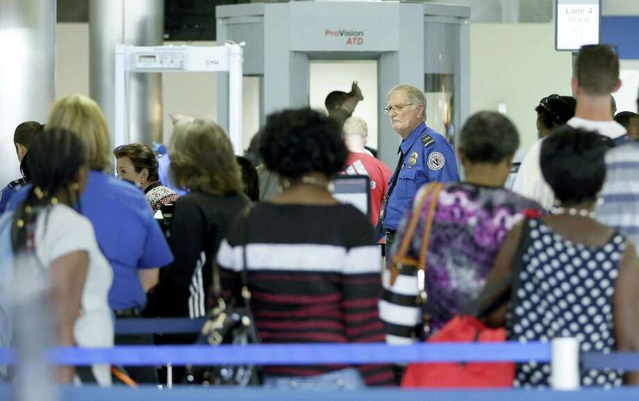 A Transportation Security Administration officer overlooks the lines as travelers prepare to be screened at a checkpoint at Fort Lauderdale-Hollywood International Airport on Friday. Photo: ASSOCIATED PRESS   / Copyright 2016 The Associated Press. All rights reserved. This material may not be published, broadcast, rewritten or redistribu