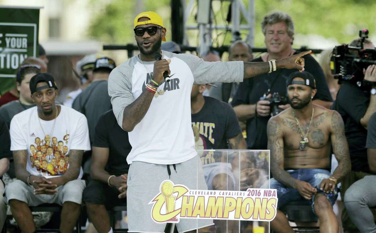 LeBron James talks about his teammates during a championship rally Wednesday in Cleveland.