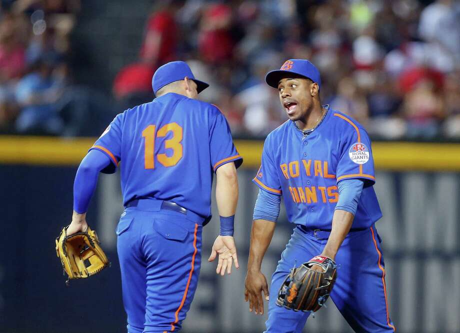 The Mets' Asdrubal Cabrera, left, and Curtis Granderson celebrate after defeating the Braves on Saturday. Photo: John Bazemore — The Associated Press   / Copyright 2016 The Associated Press. All rights reserved. This material may not be published, broadcast, rewritten or redistribu