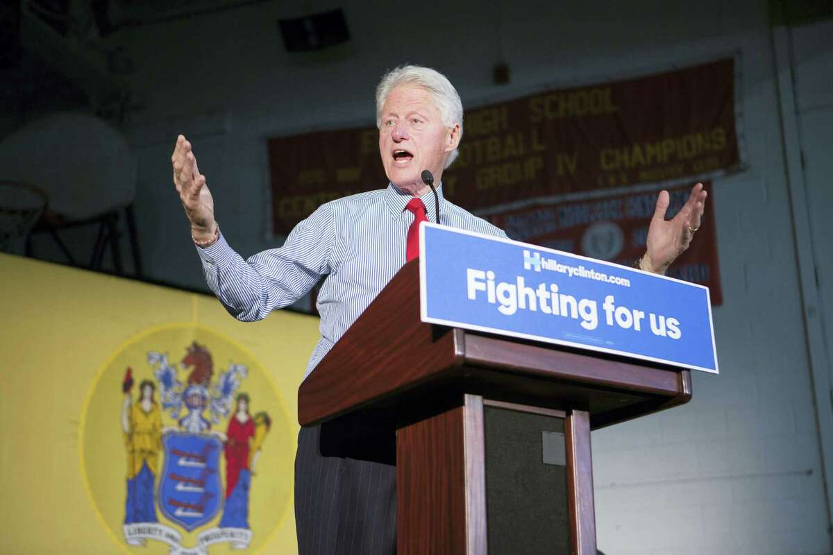 Bill Clinton campaigns for his wife, Hillary Clinton, at Edison High School on Friday.