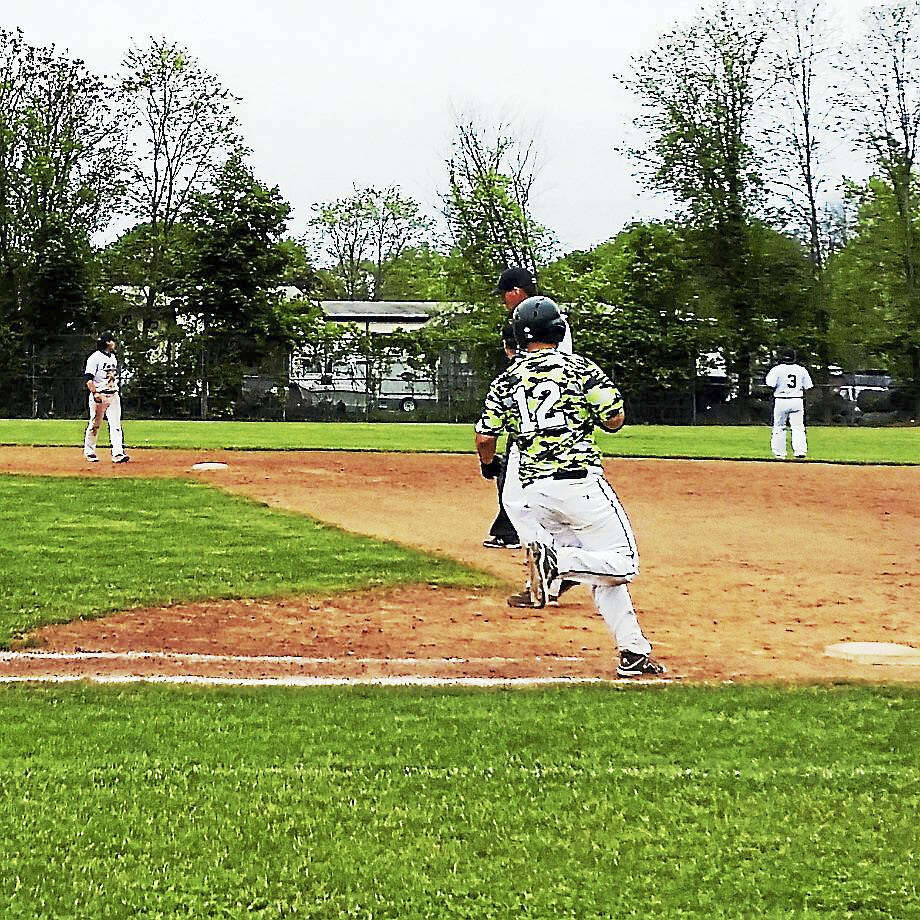 Action at the West Haven Twilight League stadium Photo: Helen Bennett - New Haven Register