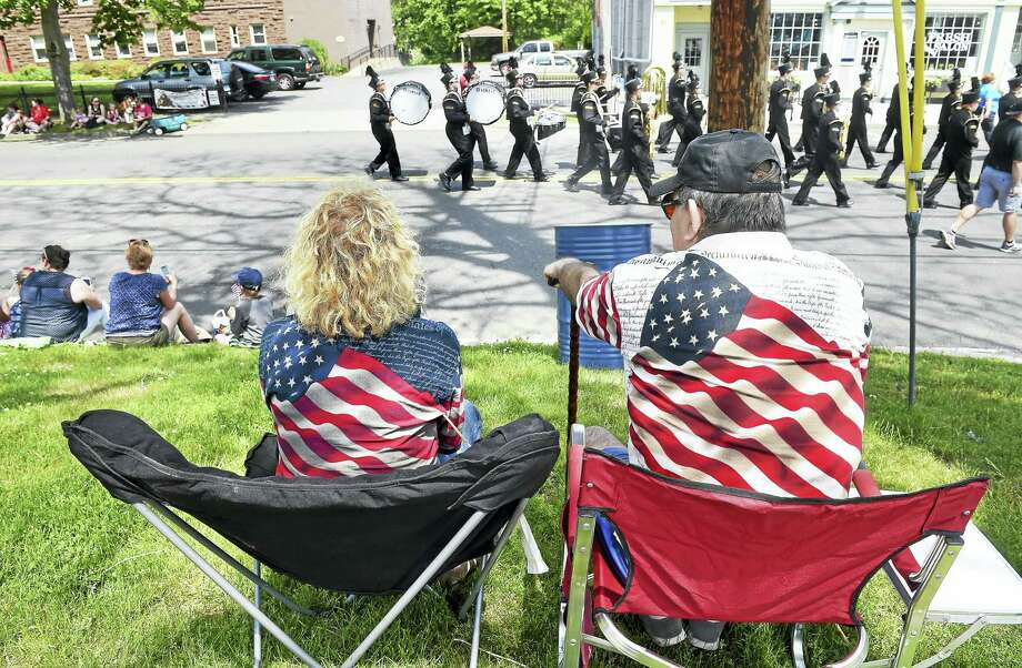 Nancy Roberto (left) and her husband, Tony, watch the Milford Memorial Day Parade go by on River St. in Milford. (Arnold Gold-New Haven Register) Photo: Journal Register Co.