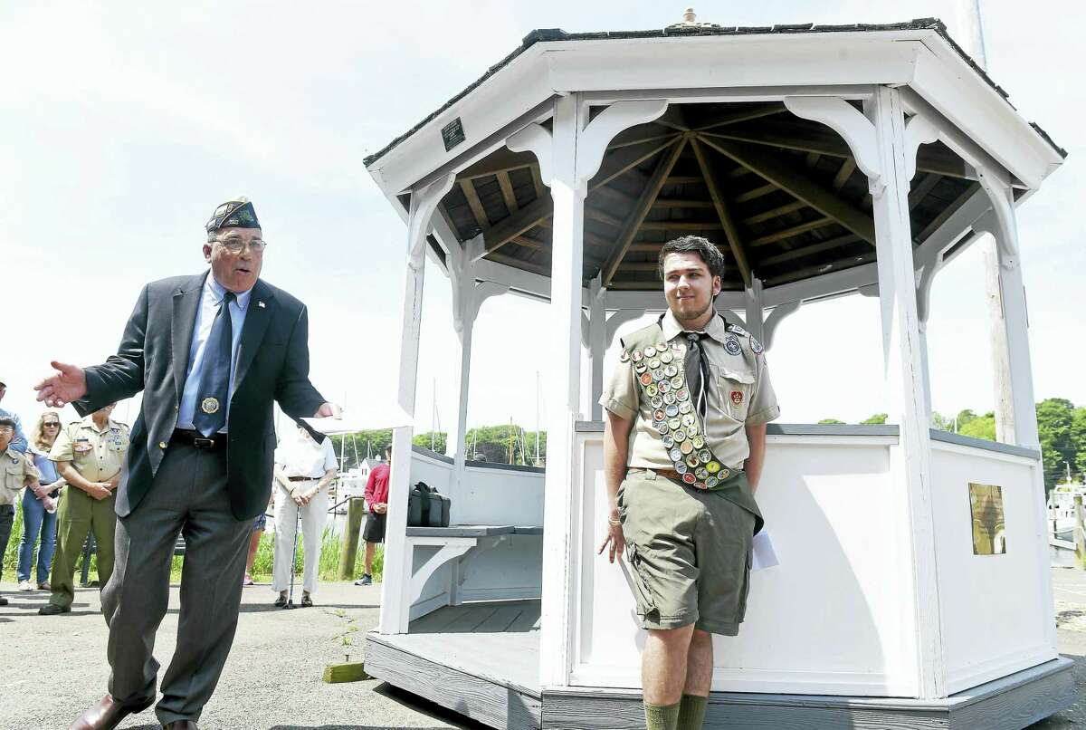 (Arnold Gold-New Haven Register) Tom Flowers (left), chairman of the Veterans Ceremony and Parade Commission, City of Milford, talks about the gazebo overlooking the Milford boat ramp that Nick Foss (right) restored as an Eagle Scout project during a ceremony on 5/29/2016.