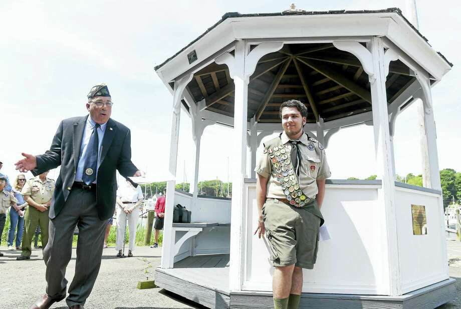 (Arnold Gold-New Haven Register)  Tom Flowers (left), chairman of the Veterans Ceremony and Parade Commission, City of Milford, talks about the gazebo overlooking the Milford boat ramp that Nick Foss (right) restored as an Eagle Scout project during a ceremony on 5/29/2016. Photo: Journal Register Co.