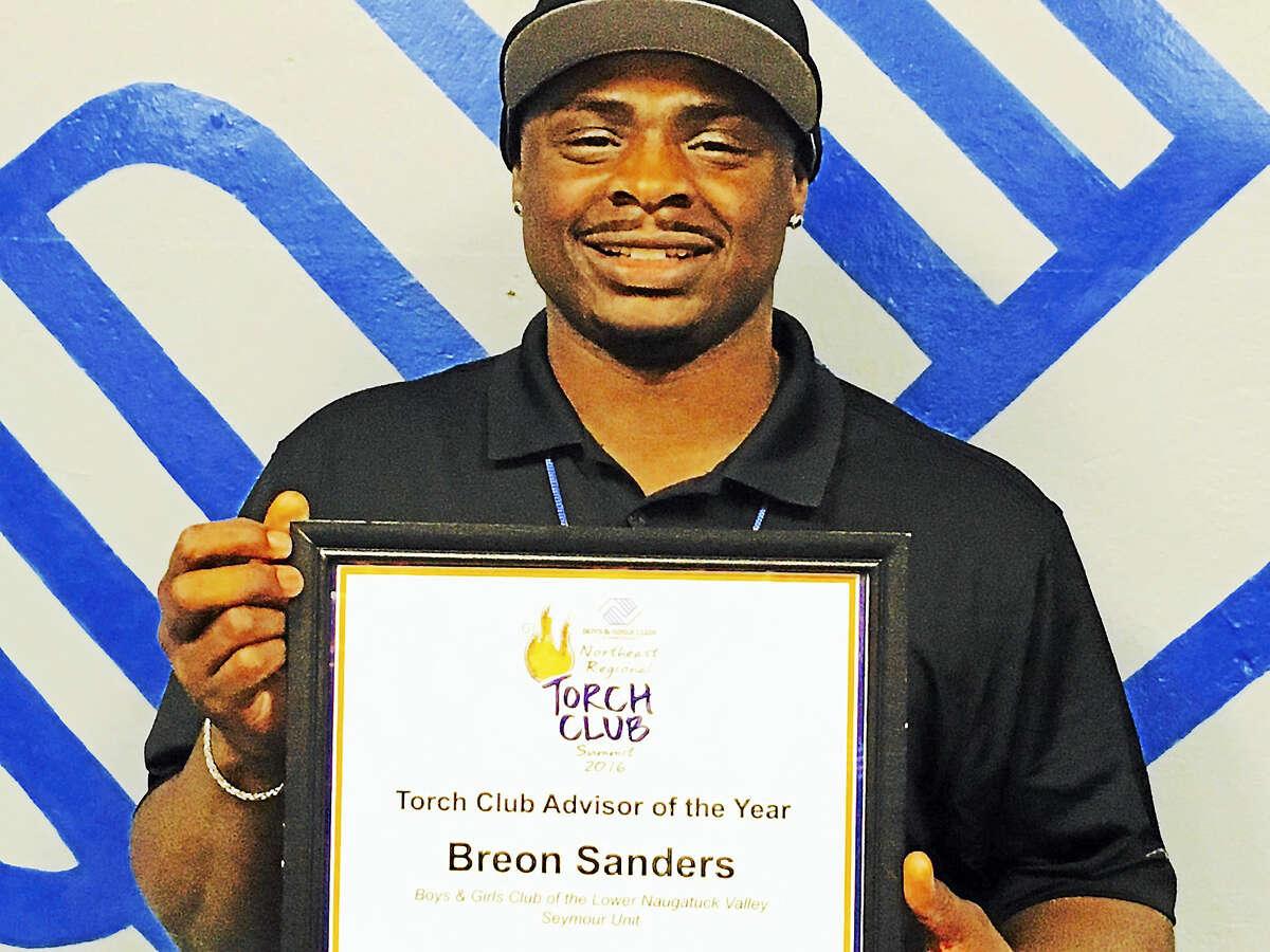 Torch Club's advisor Breon Sanders