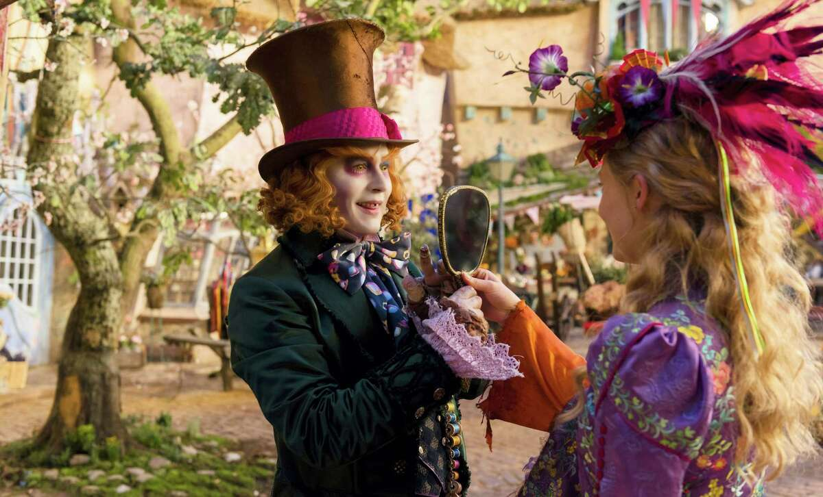 FILE - In this image released by Disney, Johnny Depp, left, and Mia Wasikowska appear in a scene from