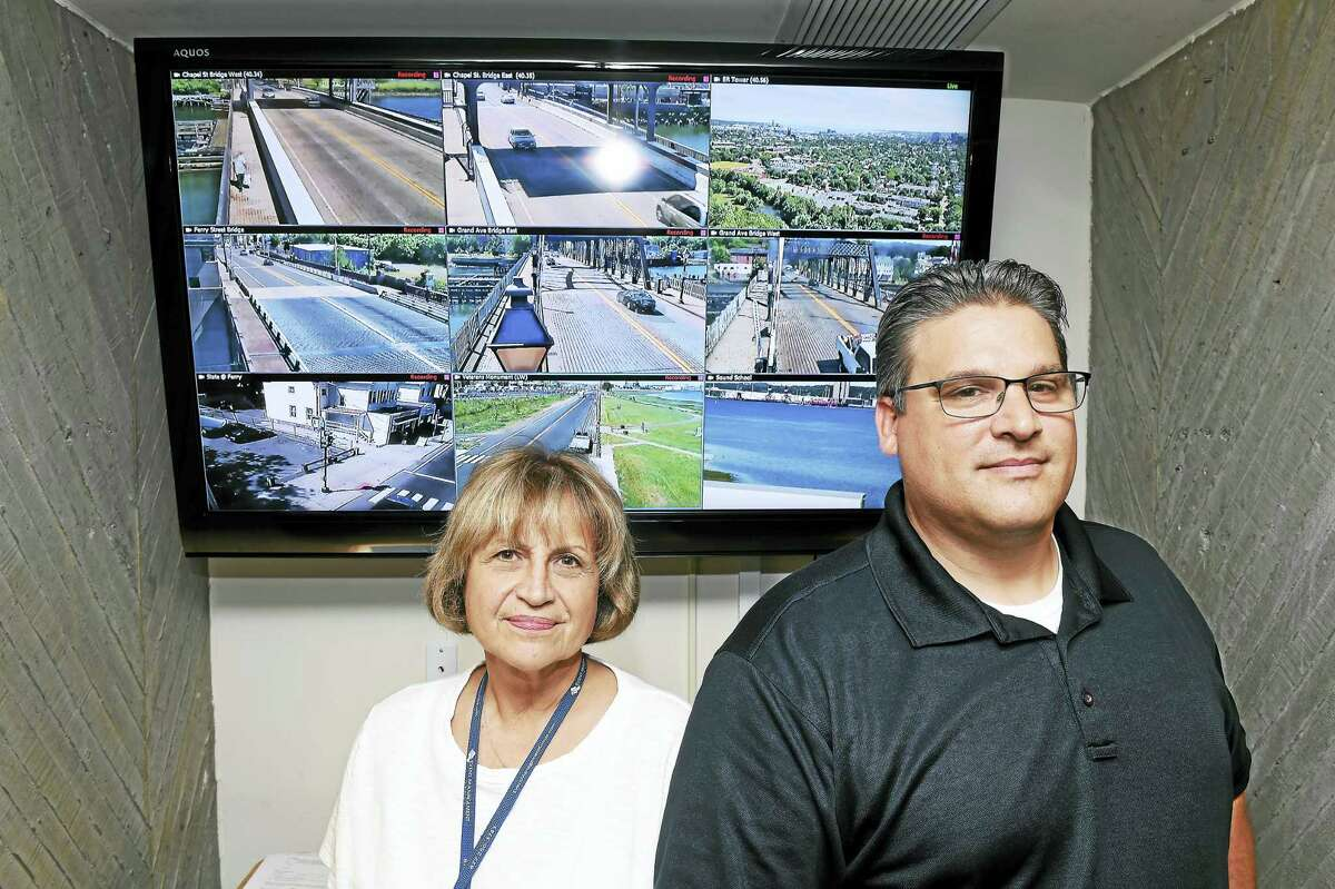Maggie Targove, center, deputy director, administration in New Haven's Office of Emergency Management, and New Haven police Lt. Herb Johnson, officer in charge, Bureau of Identification, at City Hall in front of a monitor with some of the New Haven street views available to emergency personnel.