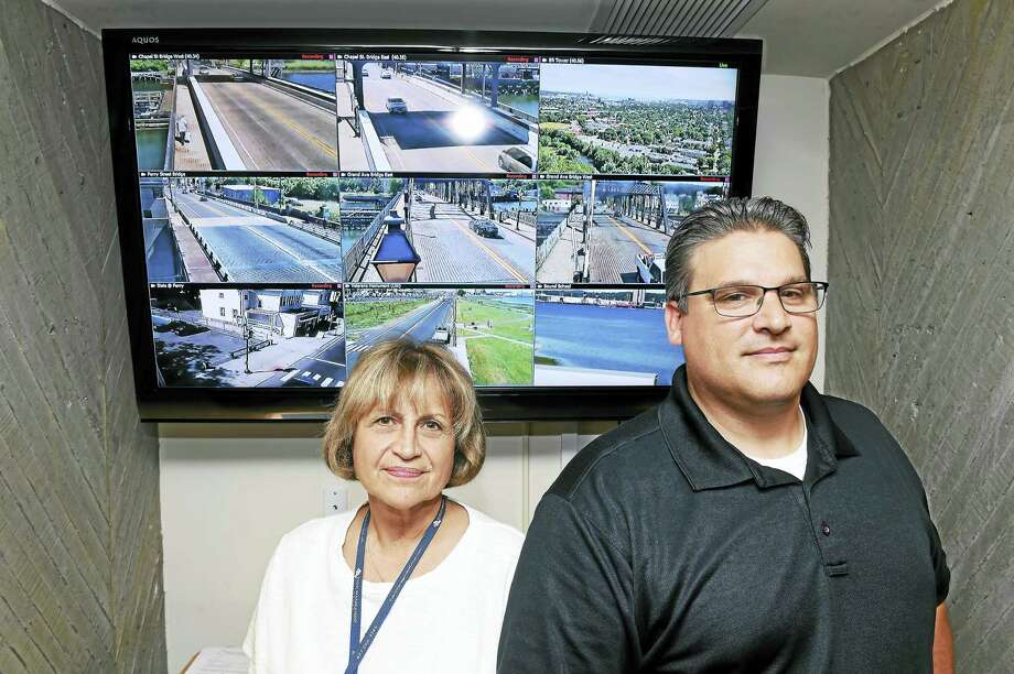 Maggie Targove, center, deputy director, administration in New Haven's Office of Emergency Management, and New Haven police Lt. Herb Johnson, officer in charge, Bureau of Identification, at City Hall in front of a monitor with some of the New Haven street views available to emergency personnel. Photo: Arnold Gold — New Haven Register