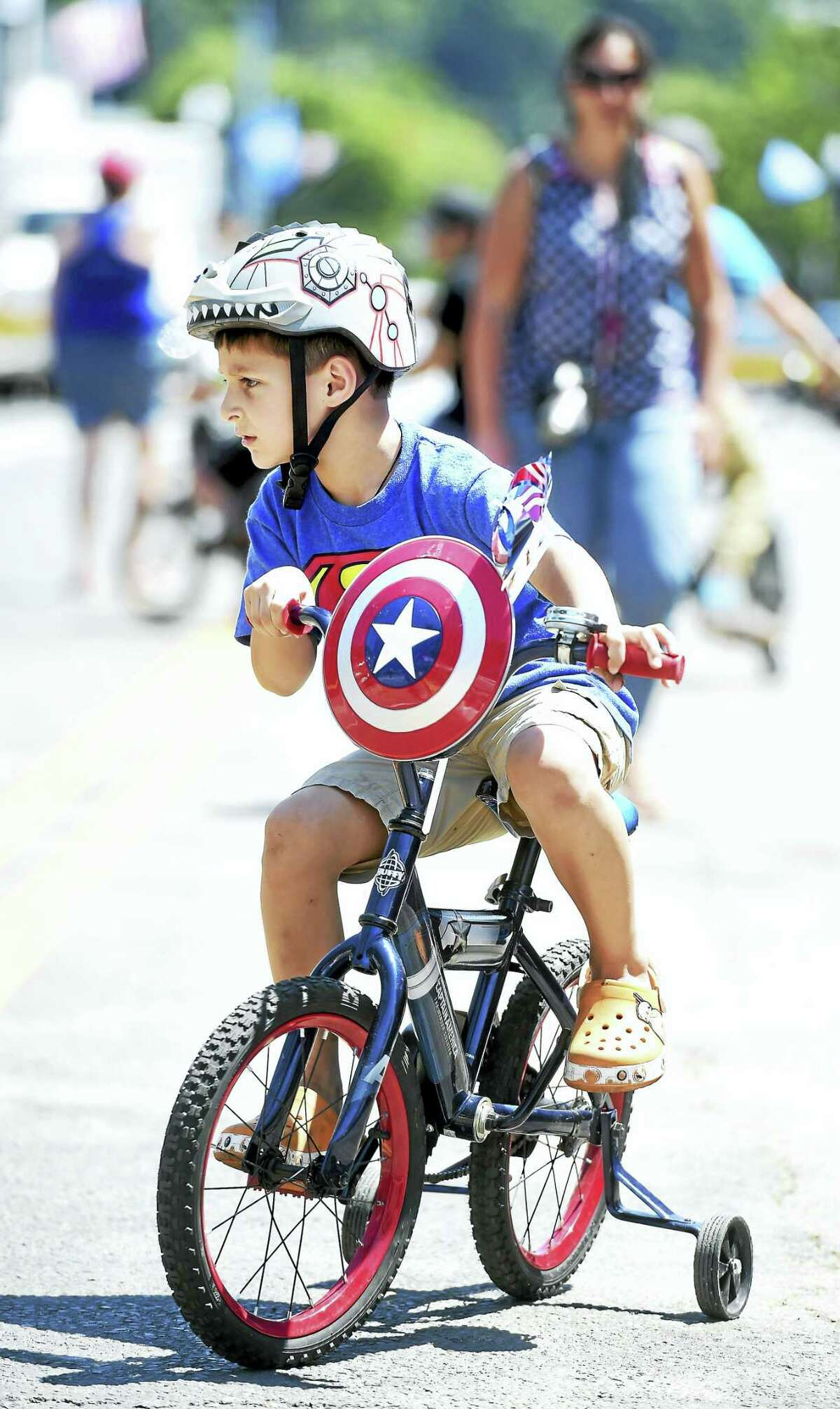 Anthony Marini, 6, of Ansonia rides his Captain America bicycle at the Pierre Lallement Bicycle Festival in Ansonia on Saturday.