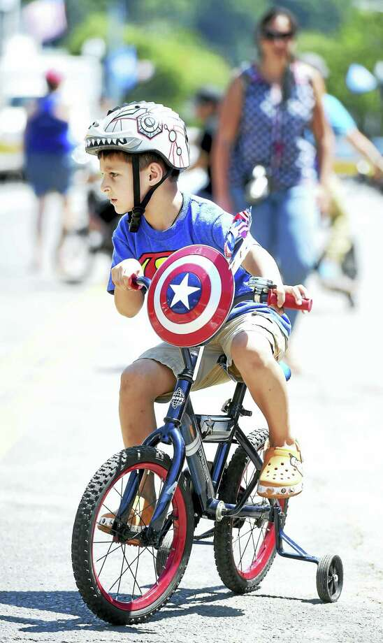 Anthony Marini, 6, of Ansonia rides his Captain America bicycle at the Pierre Lallement Bicycle Festival in Ansonia on Saturday. Photo: Arnold Gold — New Haven Register