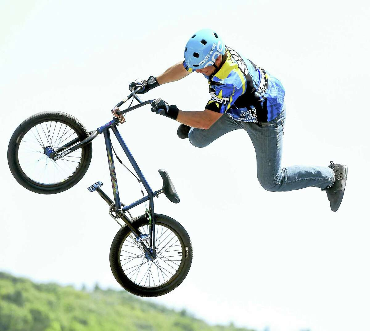 Colton Civitello of Team East performs stunts on a BMX bicycle during the Pierre Lallement Bicycle Festival in Ansonia on Saturday.