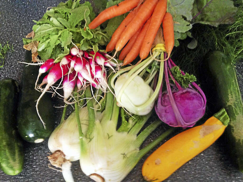 With my CSA share, I pick up a bag of fresh vegetables from a local farmer every single week, all summer long. Photo: Anna Bisaro — New Haven Register