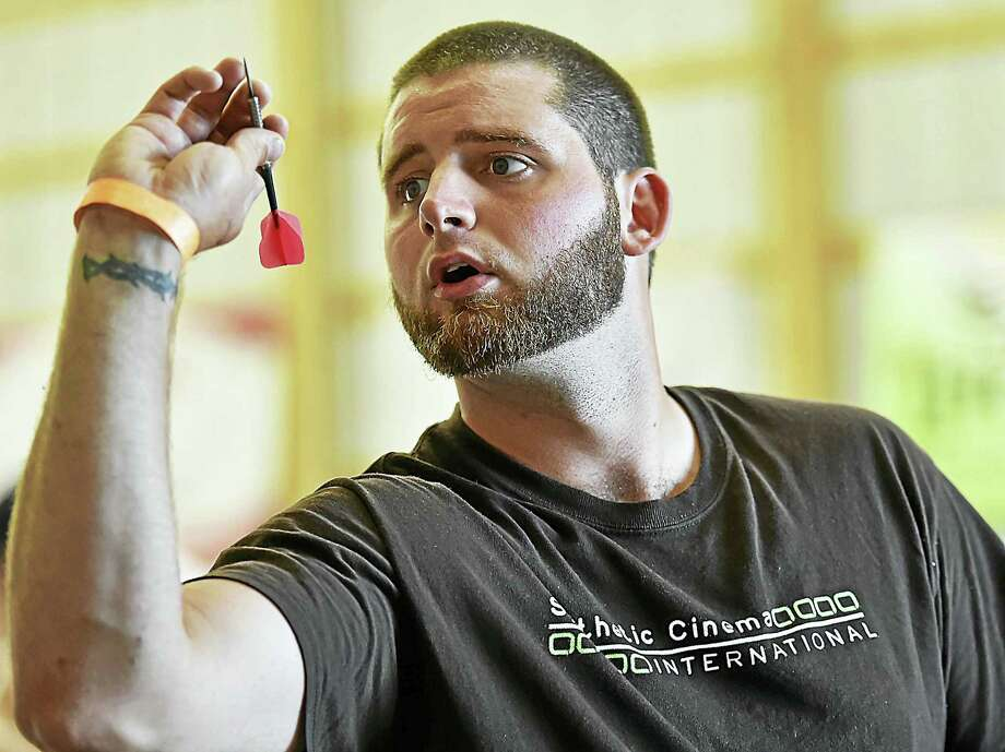 Cody Benane, of Southington competes in 2nd annual Dart Tournament at the Connecticut Irish Festival Feis and Agricultural Fair sponsored by the Irish American Community Center, Saturday, June 25, 2016, at the North Haven Fairgrounds. Benane and his partner, Tony Delmonaco, of Waterbury competed in the doubles division for a cash prize. Photo: Catherine Avalone — New Haven Register    / New Haven RegisterThe Middletown Press