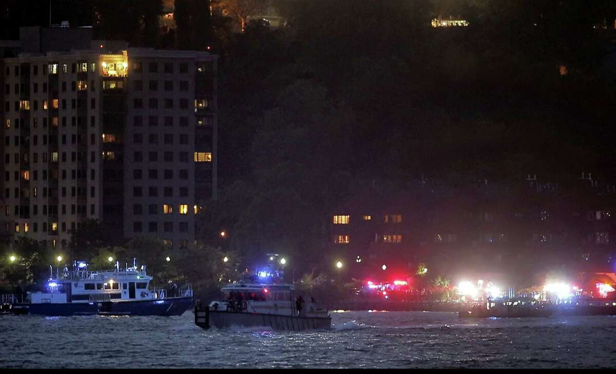 In this photo taken from video, search and rescue boats look for a small plane that went down in the Hudson River, Friday, May 27, 2016, near West New York, N.J. The Federal Aviation Administration says it received a report a World War II vintage P-47 Thunderbolt aircraft may have gone down in the river 2 miles south of the George Washington Bridge.