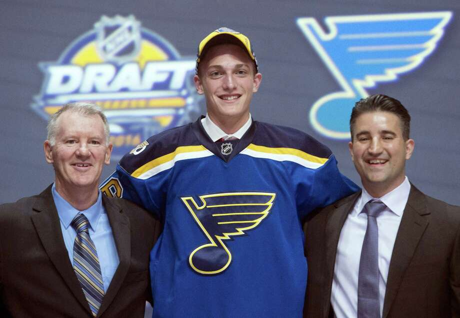 Tage Thompson, center, stands with members of the St. Louis Blues management team at the NHL draft on Friday. Photo: Nathan Denette — The Canadian Press Via AP   / The Canadian Press
