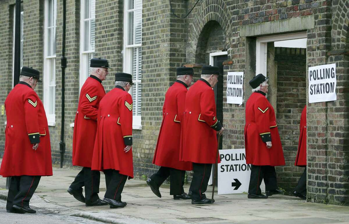 Chelsea pensioners arrive at a polling station near to the Royal Chelsea Hospital, London, to vote in Britain's EU referendum Thursday June 23, 2016. Voters in Britain are deciding Thursday whether the country should remain in the European Union a historic referendum that threatens to undermine the experiment in continental unity that began in the aftermath of World War II.
