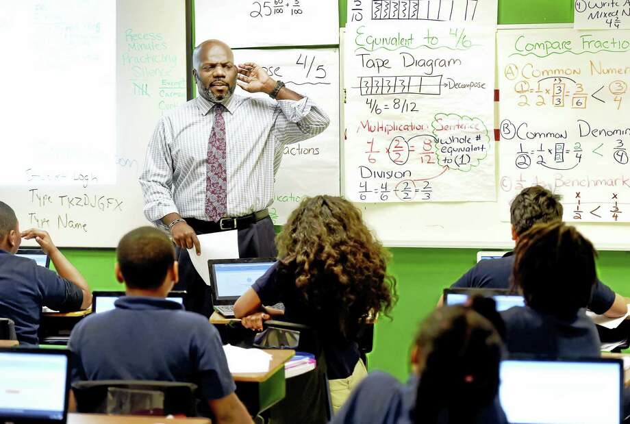 Rahsann Yearwood, fourth-grader mathematics teacher at Elm City College Preparatory Elementary school in New Haven. Photo: Peter Hvizdak - New Haven Register   / ?2016 Peter Hvizdak