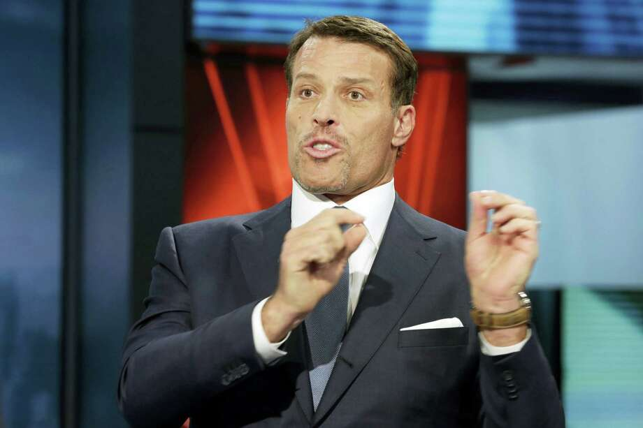 "In this March 17, 2016, file photo, motivational speaker Tony Robbins is interviewed during a taping of ""Wall Street Week,"" on the Fox Business Network in New York. Fire officials say more than 30 people attending a Tony Robbins event Thursday, June 23, 2016, in Dallas have been treated for burns after the motivational speaker encouraged them to walk on hot coals. Photo: AP Photo/Richard Drew, File    / Copyright 2016 The Associated Press. All rights reserved. This material may not be published, broadcast, rewritten or redistribu"