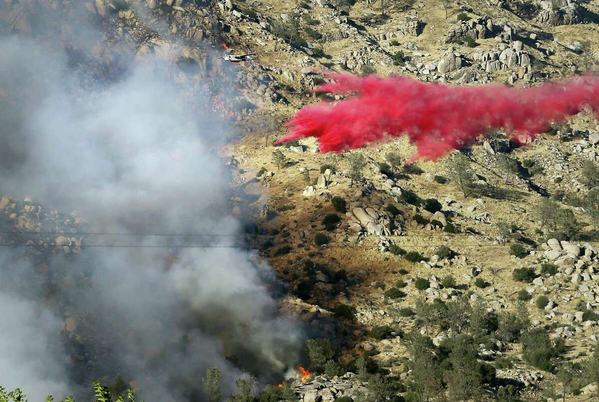 An air tanker makes a fire retardant drop on the southwest flank of the Erskine Fire near Lake Isabella, Calif., Thursday, June 23, 2016, and is moving towards Onyx.