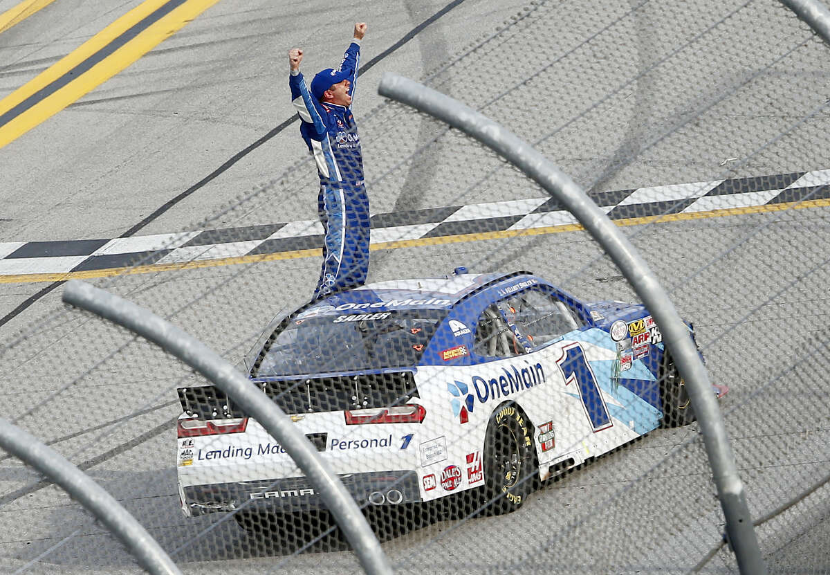 Elliott Sadler celebrates after winning the Xfinity Series race at Talladega Superspeedway Saturday in Alabama.