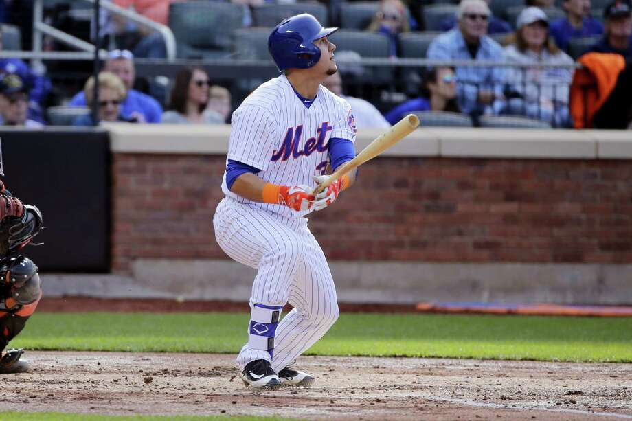 The Mets' Michael Conforto follows through on an RBI double during the second inning against the Giants on Saturday. Photo: Frank Franklin II — The Associated Press   / AP