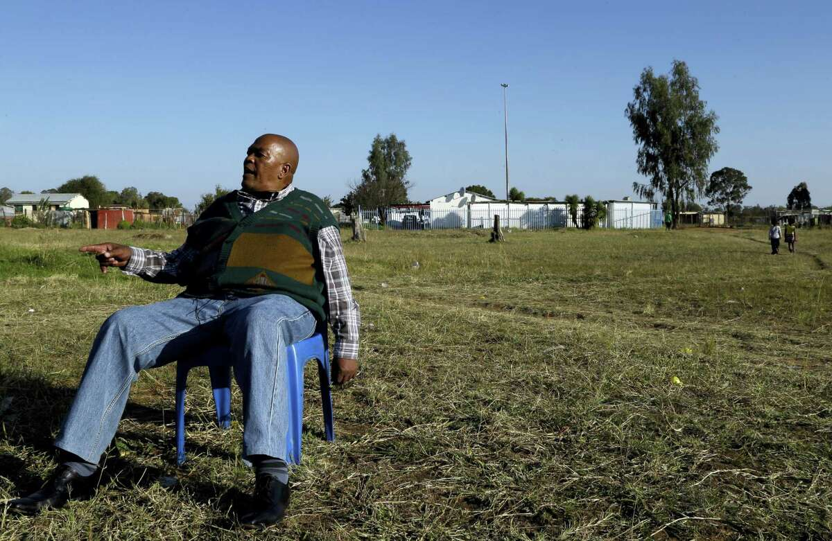 Retired mine worker William Mothabeng speaks to The Associated Press during an interview at a park in Welkom, South Africa. Tens of thousands of South African miners with lung disease prepare to sue some of the country's largest gold mining companies.