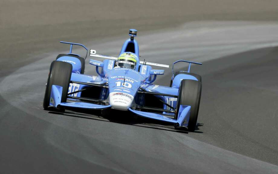 Tony Kanaan, of Brazil, drives through turn one during the final practice session for the Indianapolis 500 auto race at Indianapolis Motor Speedway in Indianapolis, Friday, May 27, 2016. Photo: Michael Conroy — The Associated Press   / Copyright 2016 The Associated Press. All rights reserved. This material may not be published, broadcast, rewritten or redistribu