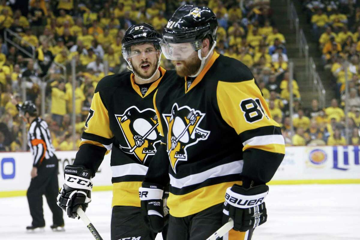 Pittsburgh Penguins' Sidney Crosby (87) and Phil Kessel (81) prepare for a face-off during the second period of Game 7 of the Stanley Cup Eastern Conference finals against the Tampa Bay Lightning Thursday in Pittsburgh. The Penguins won 2-1.