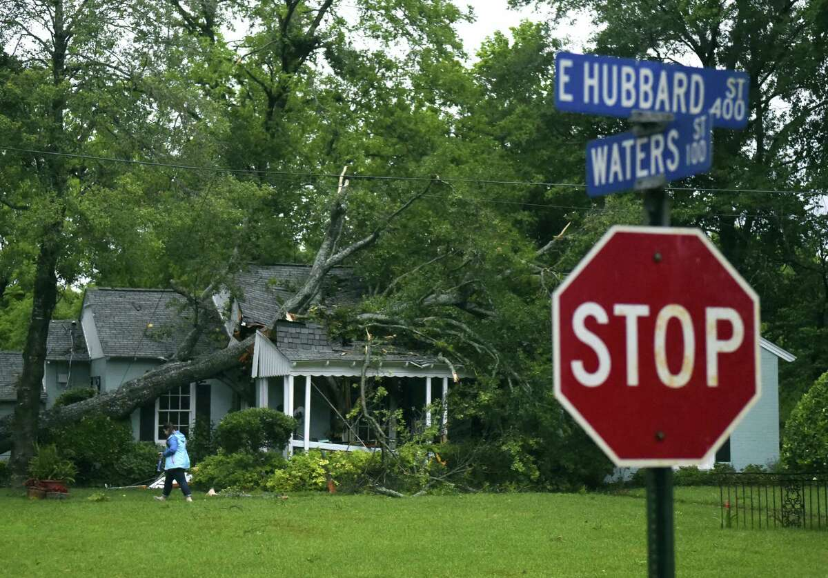 A tree fell through a home on E. Hubbard Street in Lindale Friday April 29, 2016, in Tyler. Possible tornado activity near occurred in the East Texas area Friday April 29, 2016.