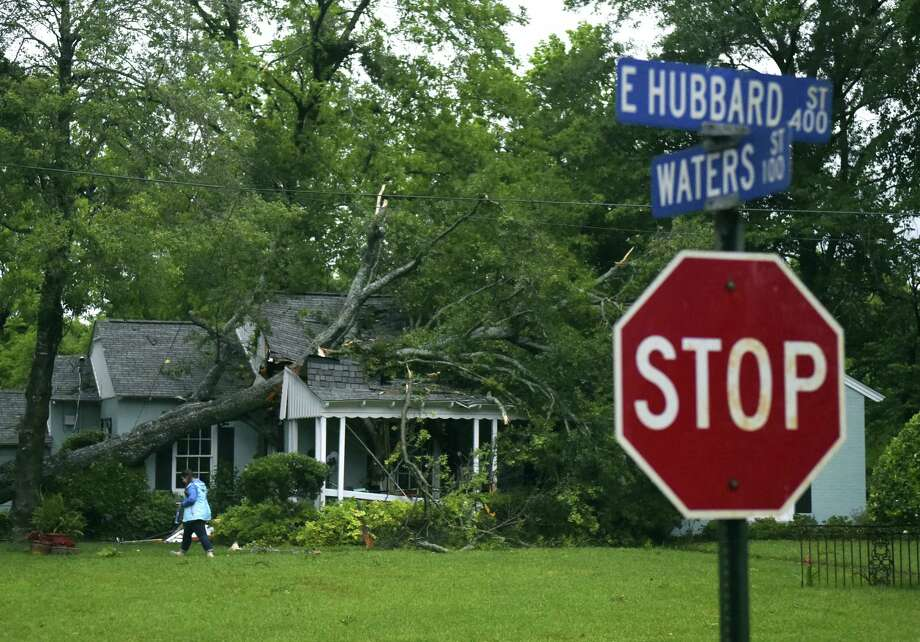 A tree fell through a home on E. Hubbard Street in Lindale Friday April 29, 2016, in Tyler. Possible tornado activity near occurred in the East Texas area Friday April 29, 2016. Photo: Sarah A. Miller/Tyler Morning Telegraph Via AP    / Tyler Morning Telegraph