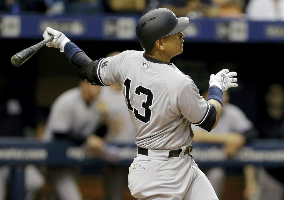 Alex Rodriguez follows the flight of his two-run home run in the sixth inning Friday. Photo: Chris O'Meara — The Associated Press   / Copyright 2016 The Associated Press. All rights reserved. This material may not be published, broadcast, rewritten or redistribu