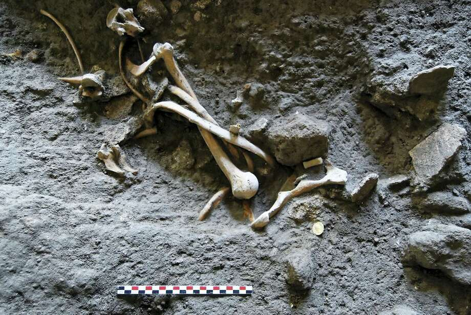 An undated picture made available by the Pompeii Archeological site Press Office, showing skeletons recently discovered in Pompeii, near Naples, Italy. An Italian and French archaeologist team, digging in the outskirts of Pompeii, have discovered four skeletons and gold coins in the ruins of an ancient shop. Pompeii archaeological site officials said Friday, June 24, 2016, the skeletons are those of young people, including an adolescent girl, who perished in the back of the shop when Mount Vesuvius erupted in 79. Photo: Pompeii Archeological Site Press Office Via AP    / Pompeii Archeological Site Press Office
