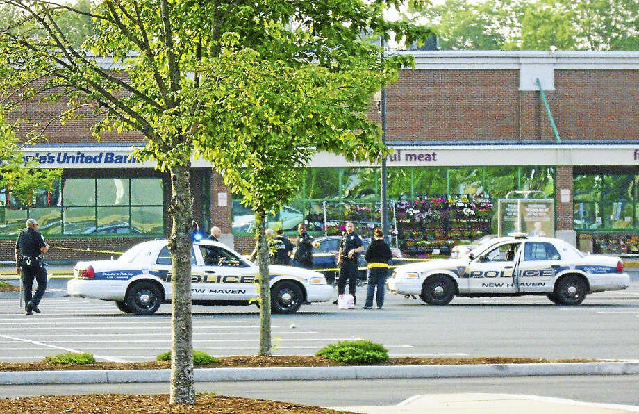 A large section of Whalley Avenue was shut down and police blocked off parts of the Stop & Shop plaza in New Haven after two men were shot in the area early Friday. Photo: Wes Duplantier — New Haven Register   / Copyright 2009
