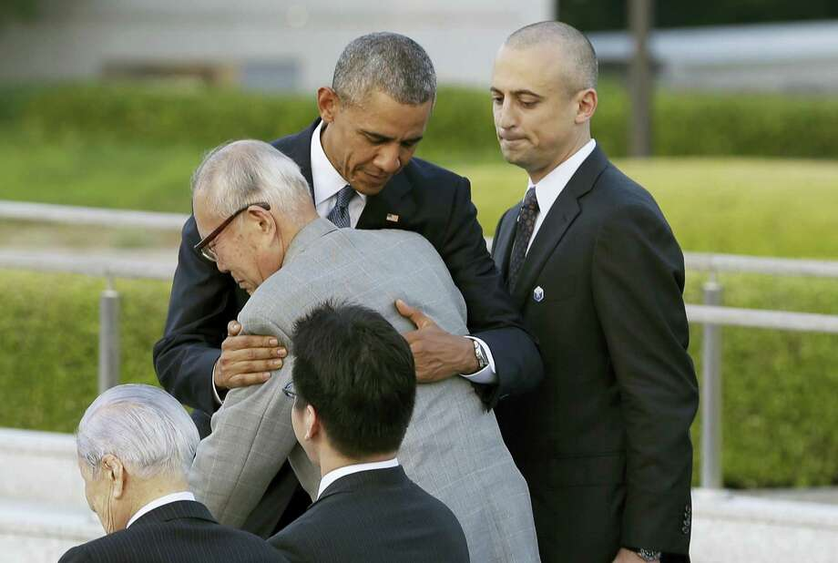 U.S. President Barack Obama hugs Shigeaki Mori, an atomic bomb survivor and a creator of the memorial for American WWII POWs killed in Hiroshima, during a ceremony at Hiroshima Peace Memorial Park in Hiroshima, western, Japan, Friday, May 27, 2016. Obama on Friday became the first sitting U.S. president to visit the site of the world's first atomic bomb attack, bringing global attention both to survivors and to his unfulfilled vision of a world without nuclear weapons. Photo: Carolyn Kaster — The Associated Press   / Copyright 2016 The Associated Press. All rights reserved. This material may not be published, broadcast, rewritten or redistribu