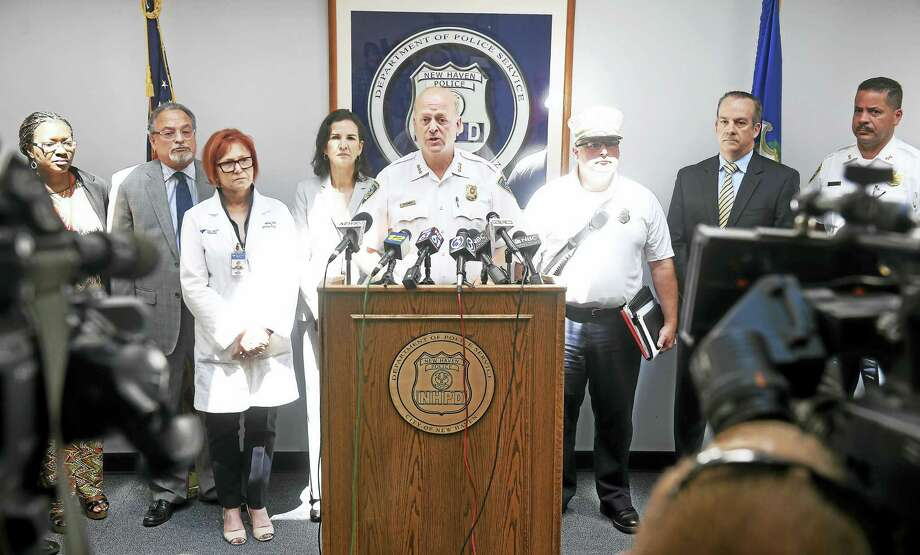 New Haven Police Chief Dean Esserman, center, speaks at a press conference at the New Haven Police Department on Friday concerning the spike in synthetic drug overdoses in New Haven and surrounding towns. Photo: Arnold Gold — New Haven Register