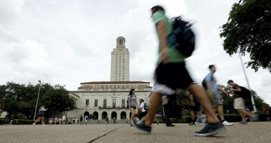 In this Sept. 27, 2012, file photo, Texas students walk past the university's iconic tower, in Austin. Photo: ASSOCIATED PRESS   / Copyright 2016 The Associated Press. All rights reserved. This material may not be published, broadcast, rewritten or redistribu