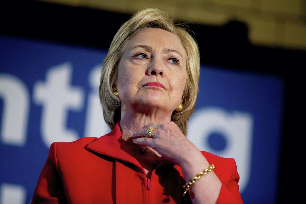 In this May 16 photo, Democratic presidential candidate Hillary Clinton waits to speak at a get out the vote event at La Gala in Bowling Green, Kentucky.