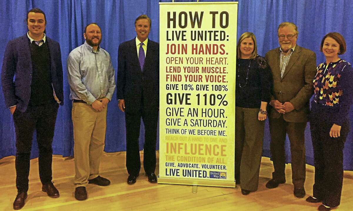 Quinnipiac University raised more than $52,000 for the United Way of Greater New Haven during its annual employee campaign, which culminated with a luncheon April 13. From left, Jacob Peterson, development officer for the United Way of Greater New Haven; Josh Berry, university registrar; Quinnipiac President John L. Lahey; Amy Terry, assistant registrar; Jack Healy, president and CEO of the United Way of Greater New Haven; and Jennifer Heath, executive vice president of the United Way of Greater New Haven. Berry and Terry served as co-chairs of Quinnipiac's United Way campaign.